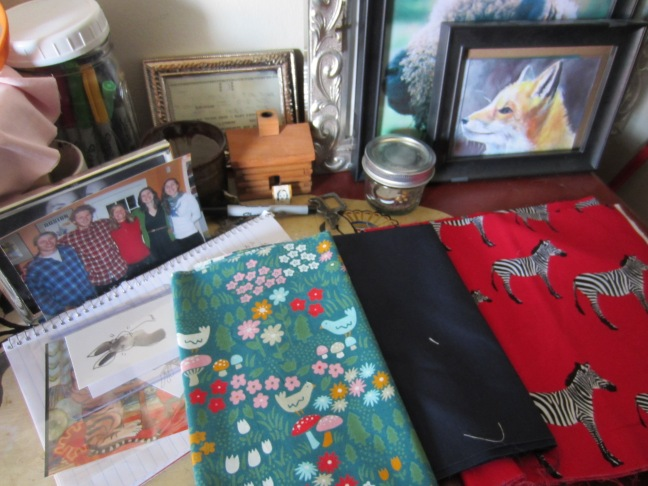 Still life with fabrics and fox